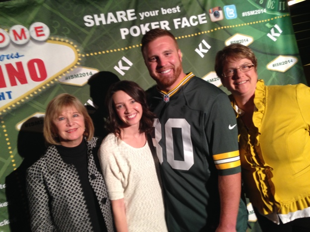 We got to meet John Kuhn at our sales meeting.  Besides me and Kuhn, that's our sales rep Judy on the left and my co-worker Kirby in the middle.  Notice I'm wearing Packer gold.  Totally not planned.  I'm just sort of awesome that way.